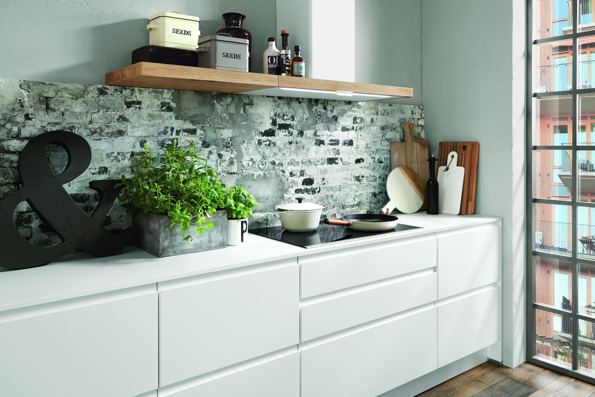 Elegante Grifflose Küche